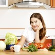 Beautiful caucasian woman in the kitchen — Stock Photo