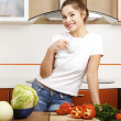Beautiful caucasian woman in the kitchen — Stock Photo #5405145