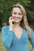 Pretty woman talking on mobile cell phone — Stock Photo