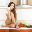 Beautiful caucasian woman in the kitchen. — Stock Photo #5423254