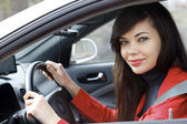 Pretty brunette driving a car — Stock Photo