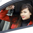 Beautiful young happy woman with car keys — Стоковая фотография