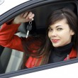 Beautiful young happy woman with car keys — Stockfoto