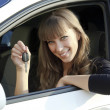 Royalty-Free Stock Photo: Pretty smiling girl holding car key
