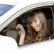 Royalty-Free Stock Photo: Pretty girl holding car key
