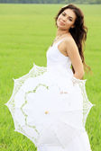 Young beautiful woman with white umbrella — Stock Photo