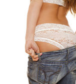 Female back in jeans and white lace panties — Stock Photo