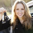 Beautiful young happy woman with car keys. — Stock Photo