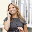Young business woman talking by phone — Stock Photo