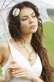 Pretty girl with white umbrella — Stock Photo