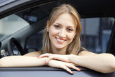 Smiling young pretty woman in the car — Stock Photo