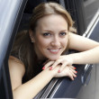 Royalty-Free Stock Photo: Smiling young pretty woman in the car