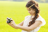 Beautiful woman with a camera — Stock Photo