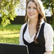 Young pretty woman with laptop — Stock Photo