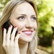 Outdoor portrait of young woman talk on mobile telephone. — Stock Photo