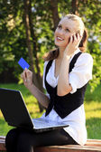 Beautiful Woman with Credit Card Using Her Laptop. — Stock Photo