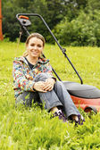 Young beautiful woman gardening and trimming the lawn — Stock Photo
