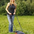 Woman mowing with lawn mower — Stock Photo