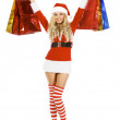 Beautiful blond woman in christmas costume with shopping bags — Stock Photo