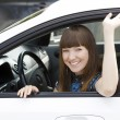 Pretty girl in a car — Foto Stock