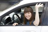 Pretty girl in a car — Foto de Stock