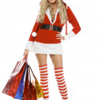 Royalty-Free Stock Photo: Beautiful blond woman in christmas costume with shopping bags