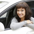 Stock Photo: Pretty girl in a car