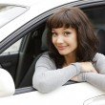 Pretty girl in a car — Stock Photo #6599502
