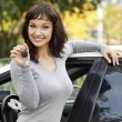 Pretty girl in a car showing the key. — Stock Photo #6601289