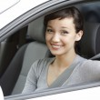 Pretty girl in a car showing the key. — Stock Photo #6602201