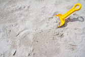 Plastic spade on beach — Stock Photo