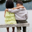 Two little kids dating in a park — Foto de Stock