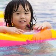 Little girl in swimming pool — Stock Photo #6493906
