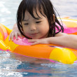 Little girl in swimming pool — Stock Photo #6493911