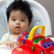 Royalty-Free Stock Photo: Little Asian baby girl on high chair