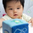 Little Asian baby girl on high chair — Stock Photo #6493923