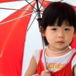 Asian child with red umbrella — Stock Photo #6553824