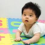 Little baby crawling on floor — Stock Photo