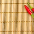 Red chilli on a bamboo mat — Stock Photo
