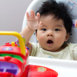 Little Asian baby girl on high chair — Stock Photo #6682676