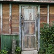 Old door of ramshackle house. — Stock Photo #6206445