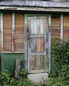 Old door of ramshackle house. — Stock Photo