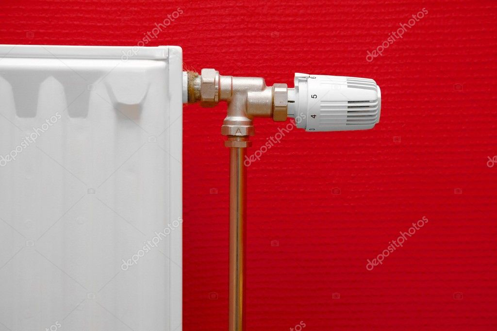 Heating radiator detail against red wall  Stock Photo #5445830