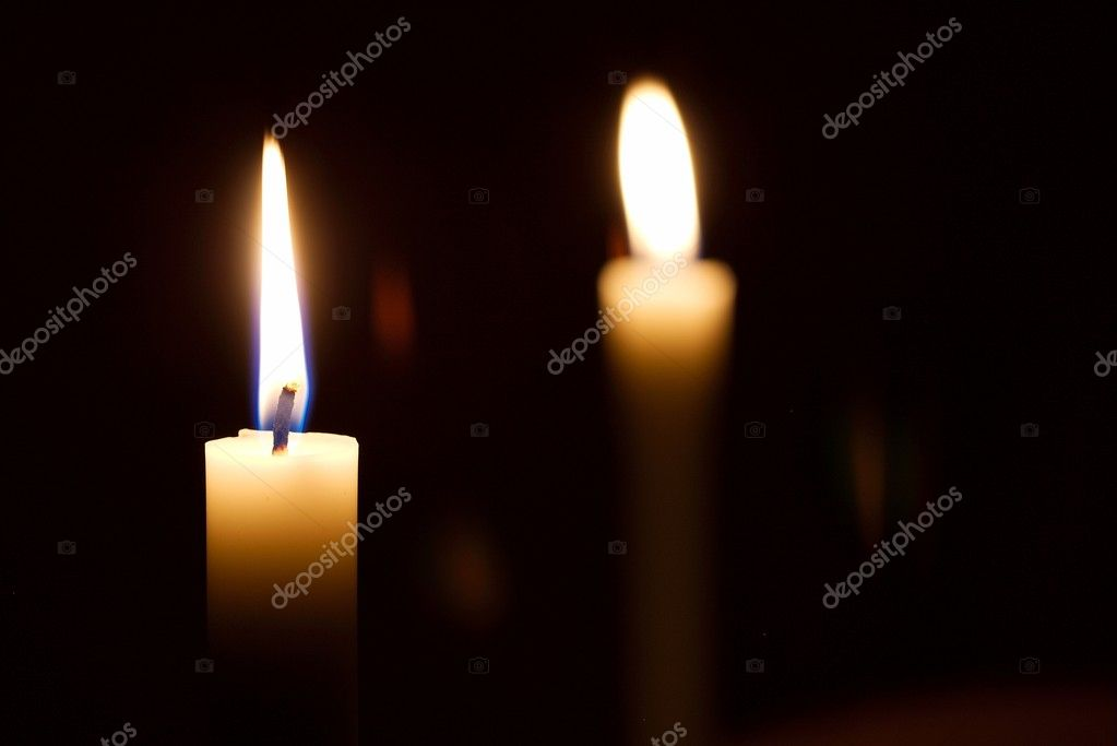 Burning candles in the dark, one of them in focus — Stok fotoğraf #5491853