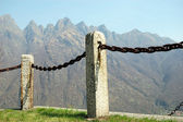 Fence made of iron and stones — Stock Photo