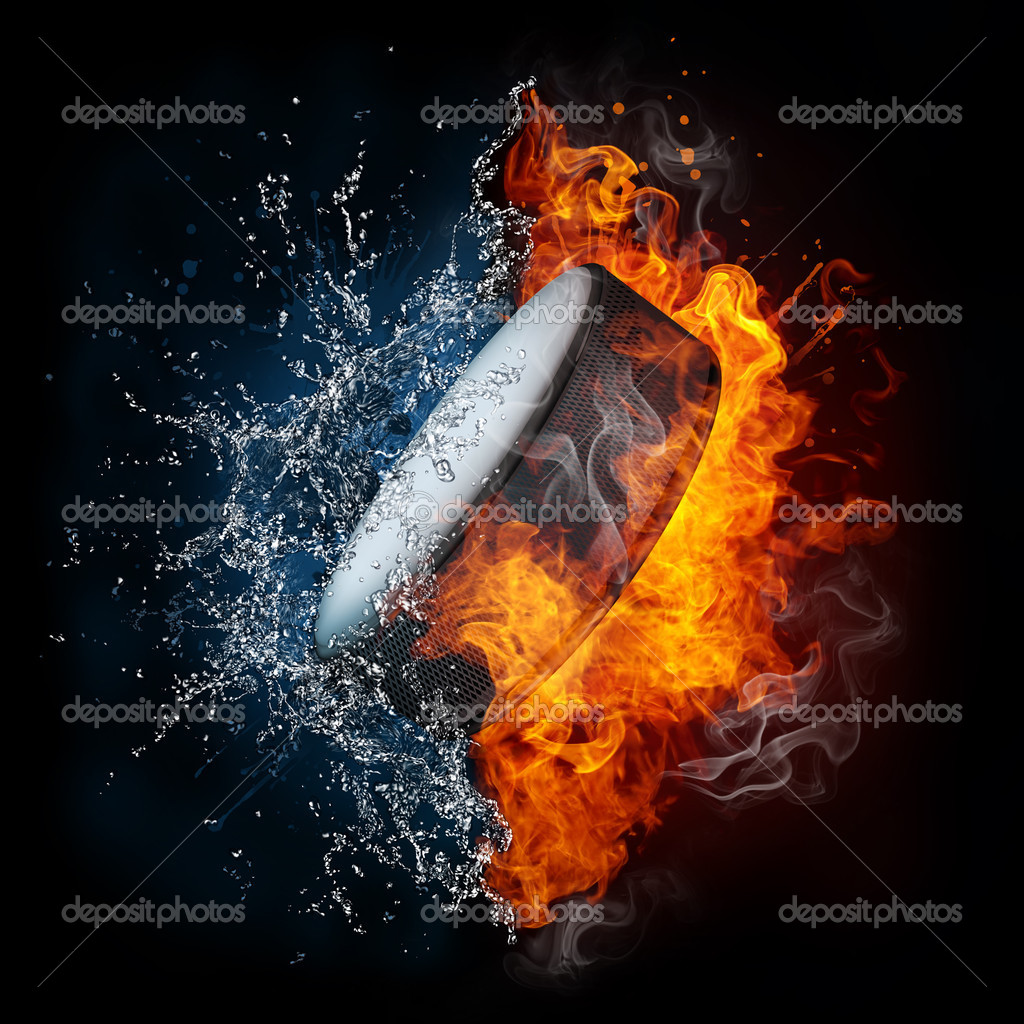 Hockey Puck in fire and Water Isolated on Black Background — Stock Photo #5832612