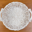 Wicker basket on table,  top view — Stock Photo