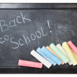 Blackboard with chalks — Stock Photo