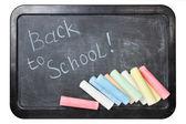 Blackboard with chalks — Stock Photo