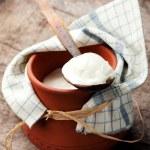 Yogurt in clay pot — Stock Photo